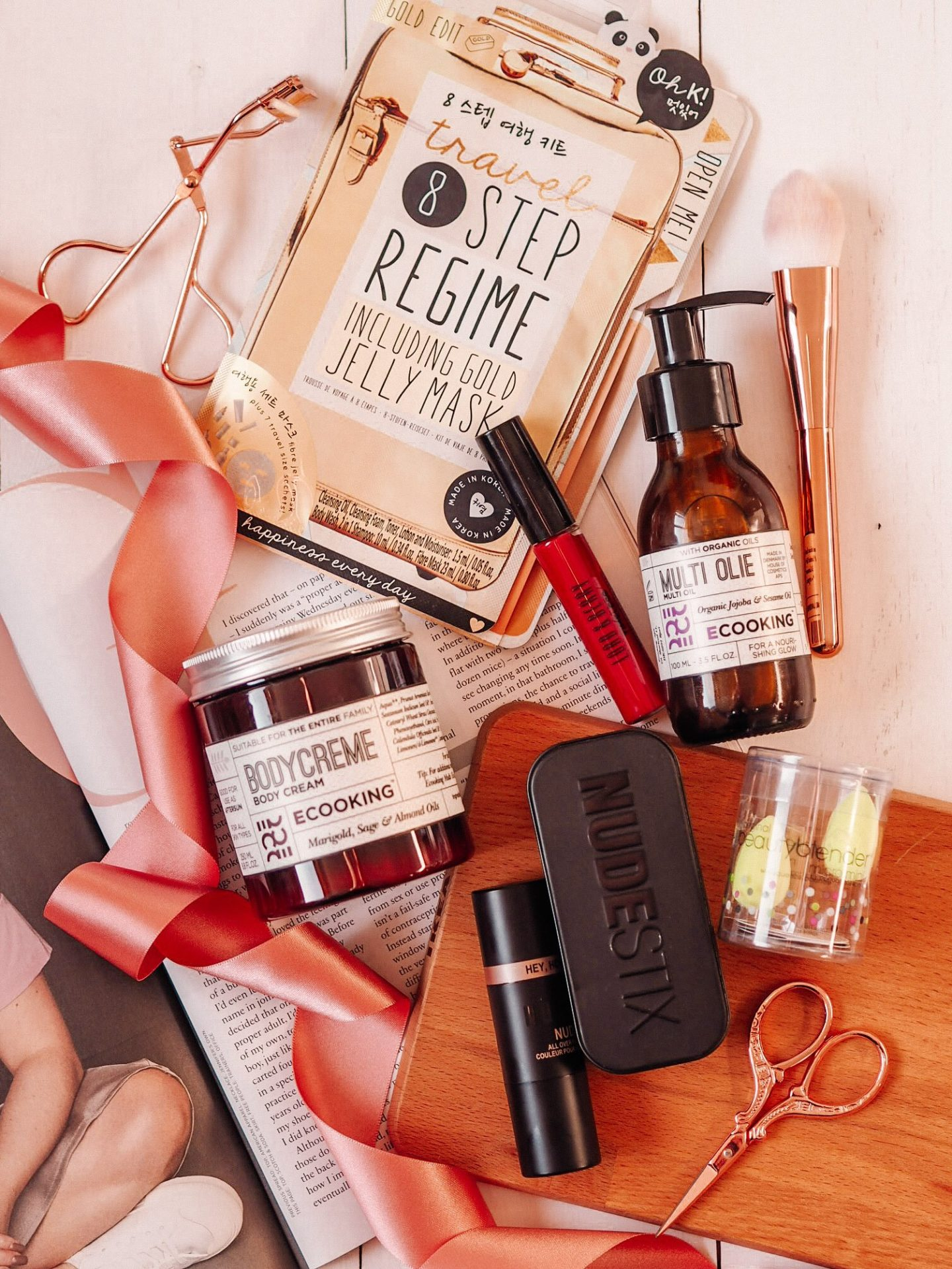 A flatlay photo of a selection of products available at Indulge Beauty