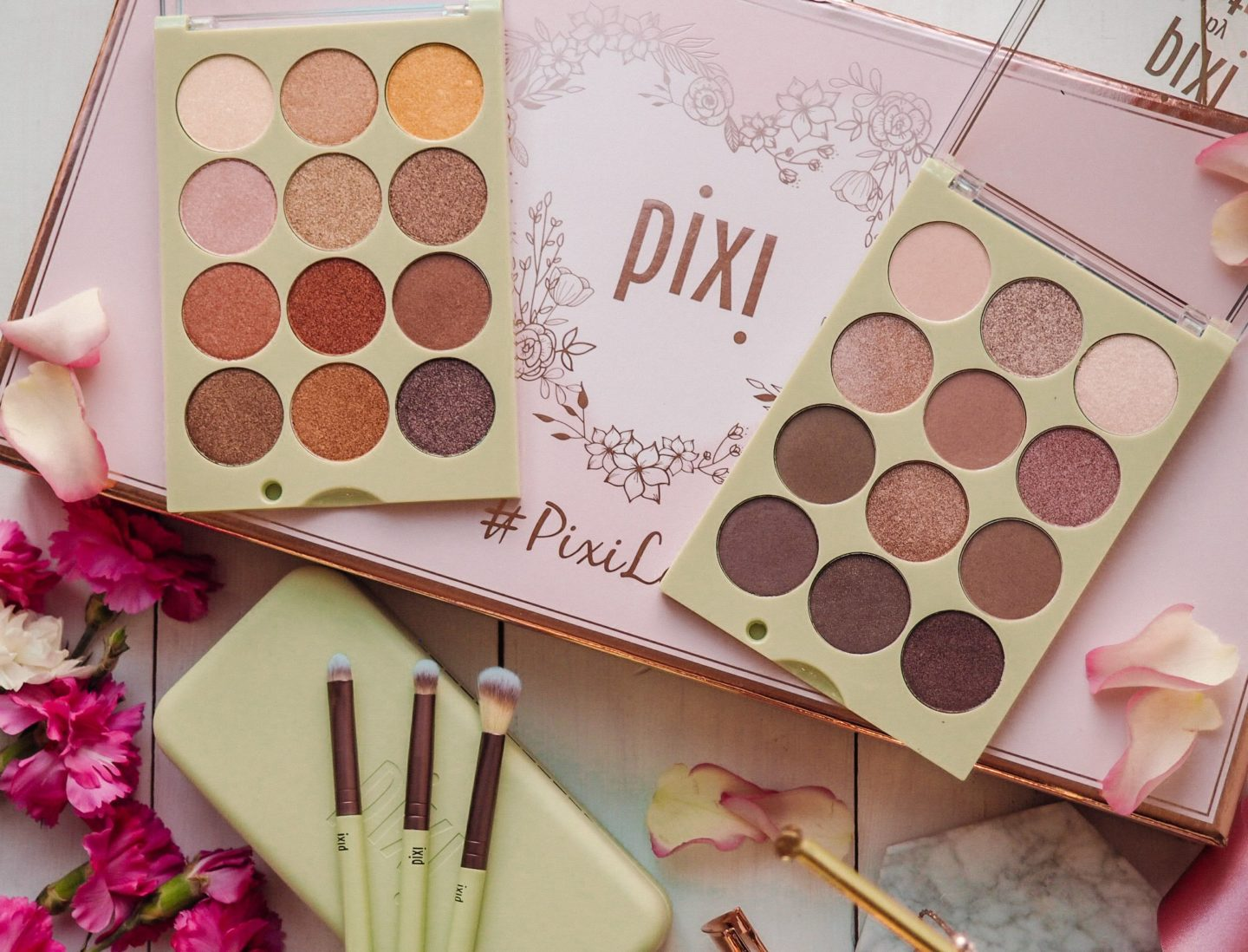 Flatlay of Pixi Eye Reflection Shadow Palettes and eyeshadow brushes