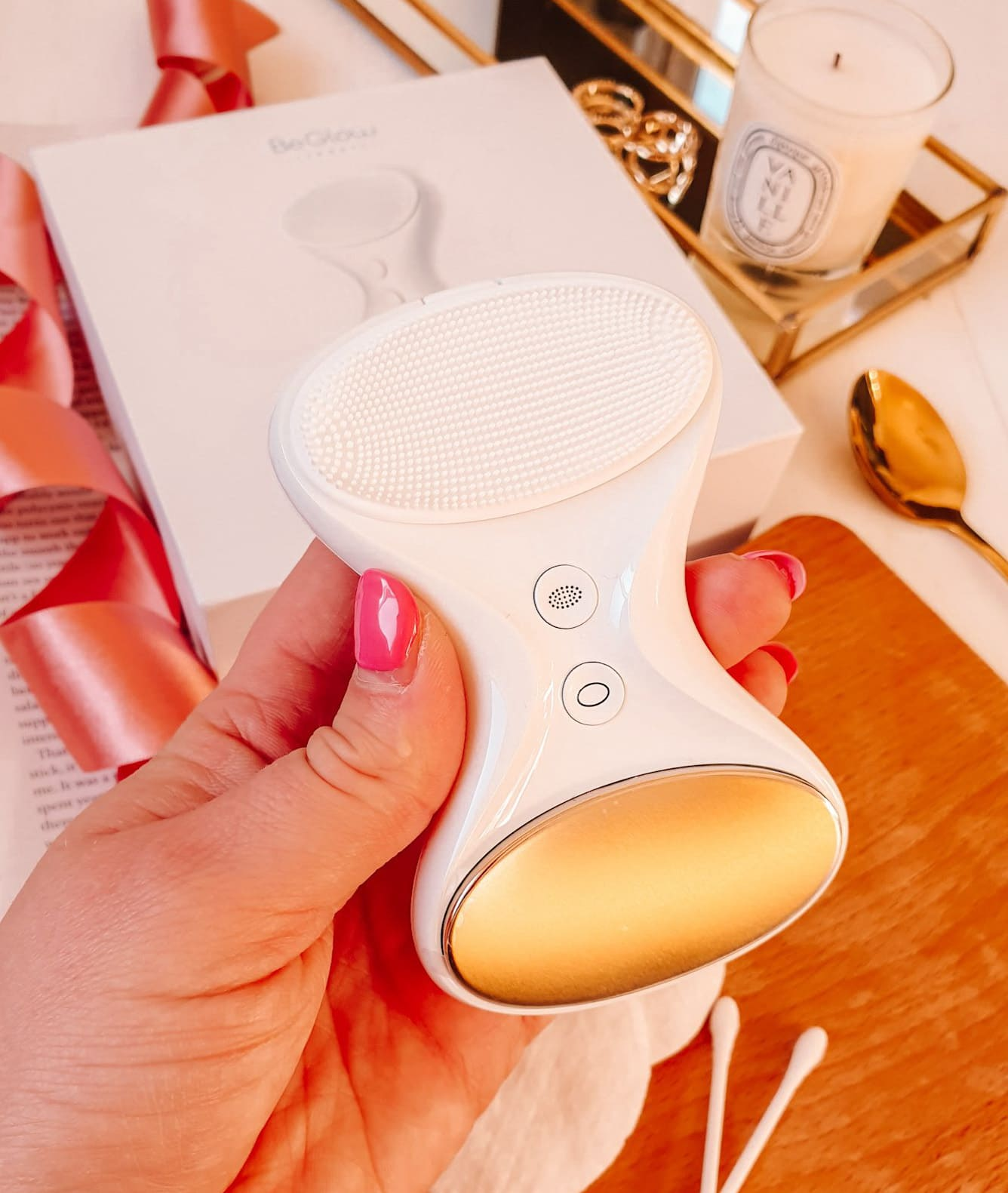 BeGlow TIA All-In-One Sonic Skin Care System in hand close up
